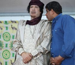Martyred Libyan leader Col. Muammar Gaddafi with his former security director Abdullah al-Senoussi. The Libyan official was turned over to the U.S.-backed rebels by the Mauritanian government on September 5, 2012. by Pan-African News Wire File Photos
