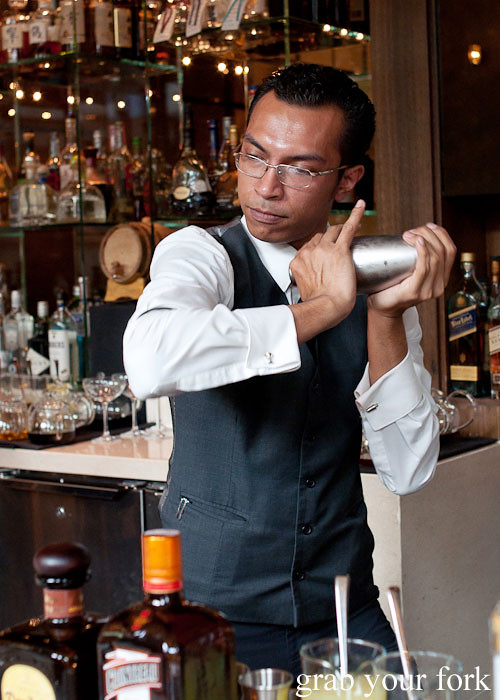 bartender irwan shaking cocktails at cut by wolfgang puck, at marina bay sands singapore