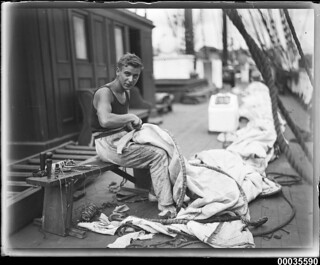 Crew member on deck preparing sails, MAGDALENE VINNEN