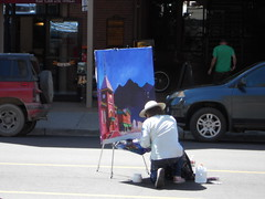 Artist working in the middle of Colorado St.