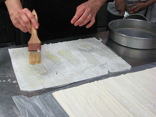 buttering filo dough at New School of Cooking