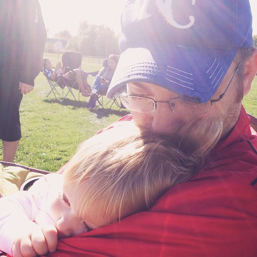 Snuggling at early morning soccer.