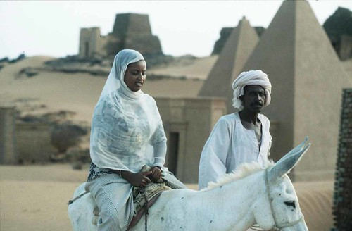 Sudanese ride through the ancient pyramids at Meroe in the Republic of Sudan. The Sudan pyramids have been there for thousands of years. by Pan-African News Wire File Photos