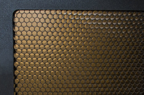 "The ""honeycomb Grid"" is a simple device to direct the light in a tight beam."