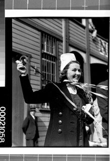 A woman farewells sailors on board SS AUTOLYCUS departing Sydney for Portsmouth, 13 May 1939