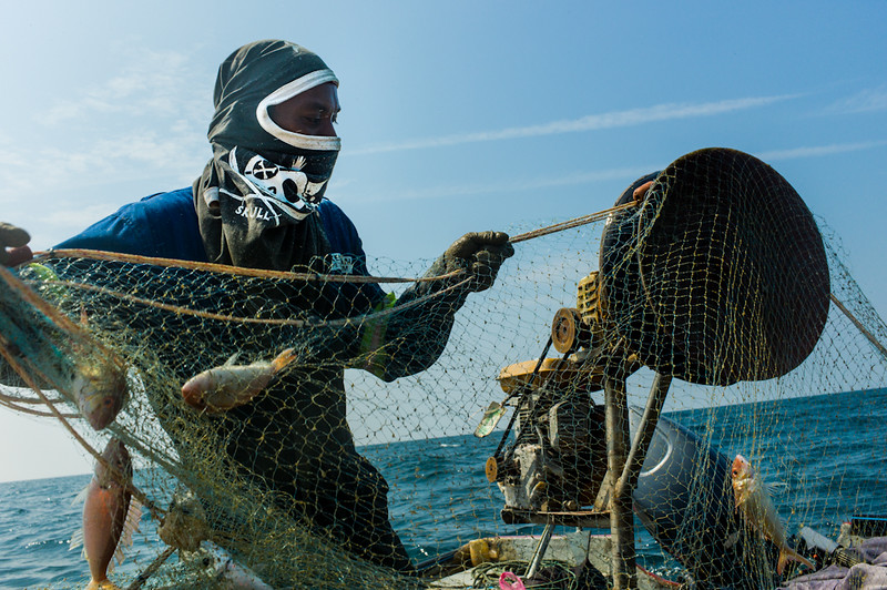 A fisherman reels in the catch of the day in the South China Sea - This image was exhibited at the Leica Gallery Singapore earlier this year.