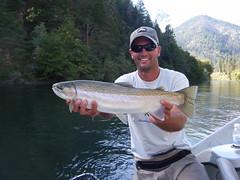 Trinity River fly fishing guide Jeremy Baker with an early season Steelhead