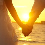 Holding Hands Young adult male groom and female bride holding hands on beach at sunset. WONG SZE FEI - Fotolia