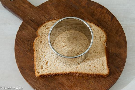 preparing to cut hole in bread