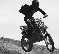 automobile(1.0), racing(1.0), freestyle motocross(1.0), vehicle(1.0), motorcycle(1.0), motorsport(1.0), motorcycle racing(1.0), monochrome photography(1.0), extreme sport(1.0), motorcycling(1.0), supermoto(1.0), stunt performer(1.0), monochrome(1.0), black-and-white(1.0), stunt(1.0),