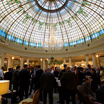 Delegates enjoying a cocktail under the Crystal Dome at the Westin Palace Hotel