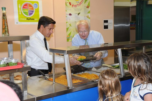 US Kevin Concannon and Miami-Dade County School Superintendent Alberto Carvalho serve lunch to students from North Beach Elementary School, Miami, FL, on August 23, 2012. (USDA photo by Debbie Smoot).