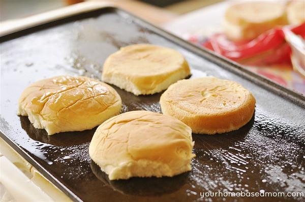 hamburger buns on a griddle