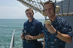 Seaman Nicholas Fisher, left, and Seaman Abel Cardona stand fantail watch aboard USS John C. Stennis. The tworeported seeing a man in the water Oct. 6 as the ship transited through the Strait of Singapore. (U.S. Navy photo by Mass Communication Specialist 3rd Class Justin A. Johndro)