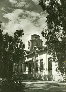 Exterior view of the Harwood Hall of Botany with Mason Hall in the background. Harwood was built in 1915 and demolished in 1968.