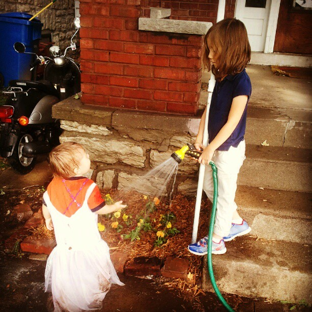 Watering he flowers (and each other).