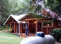 David posing in front of Bob's Cabin