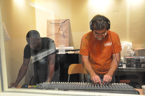 Damond and Tony at the mixing board for performances.  Photo by Kichea S Burt.