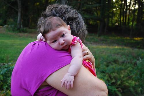 Grandma happily holds Caroline