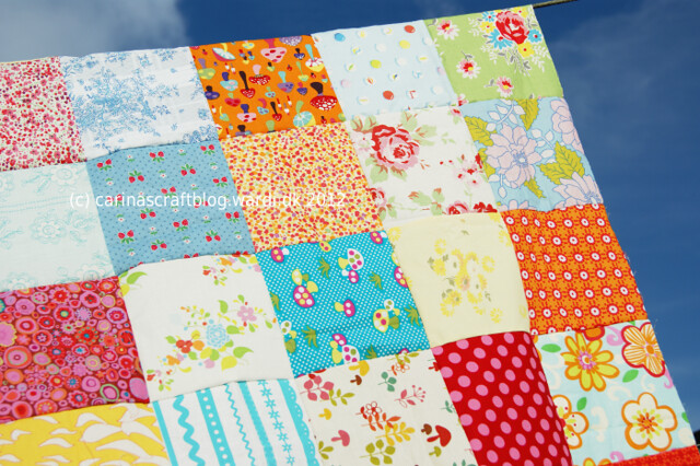 Small multi colour quilt top