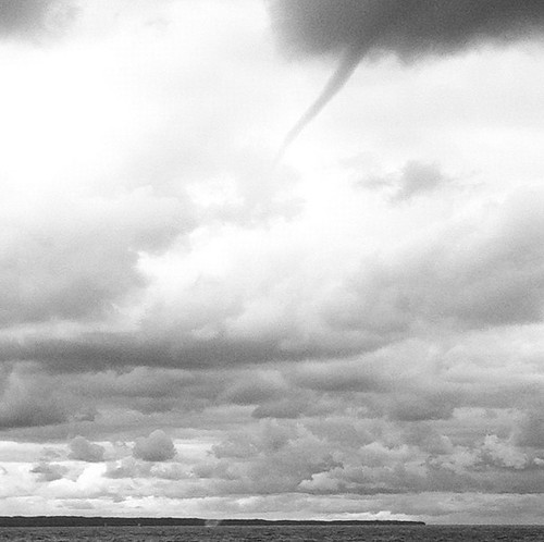 Waterspout moves across the Manitou Passage in the Sleeping Bear Dunes National Lakeshore