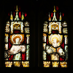 two angels with Sanctus scrolls