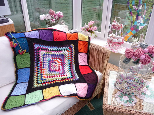 I love the idea of the Granny Square in the middle and smaller ones around it.