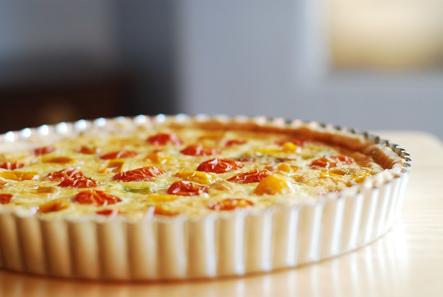 Egg and Cheese Breakfast Tart with Grape tomatoes, thyme