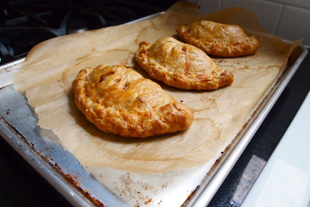 Baked pasties in a row