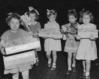 Young girls carrying flower displays at the Chelsea flower show in Brisbane 1952