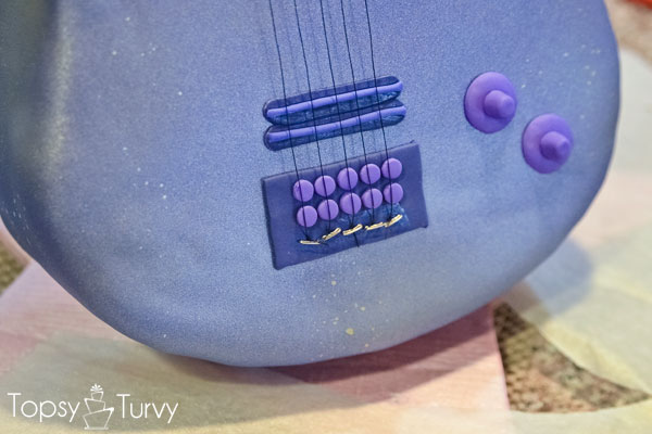 standing-guitar-cake-carved-fondant-upholstry-strings