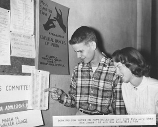 """Kim Jones '60 and Sue Love Hill '60 look over the 1957 """"matriculation day list."""""""