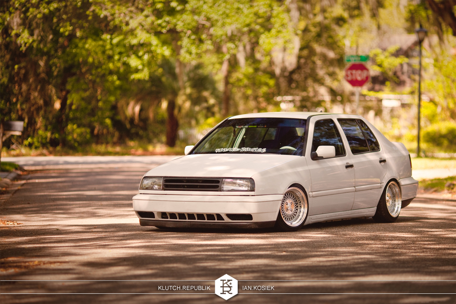 "Slammed volkswagen jetta mk3 with klutch wheels sl1 silver 15x8.5"" with aggressive fitment stance stanced stretched tires"