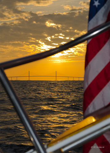 Sunset, Flag & Sunshine Skyway Bridge...leaning into Tampa Bay