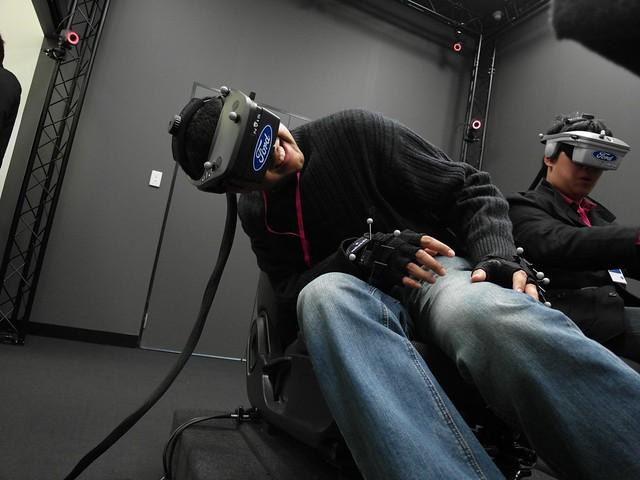 Neerav Bhatt sitting in Ford Australia Virtual Reality 3D Car Simulator, viewing *inside* the car door lock