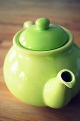 glass(0.0), produce(0.0), vase(0.0), jade(0.0), lighting(0.0), ball(0.0), apple(0.0), art(1.0), yellow(1.0), green(1.0), ceramic(1.0), teapot(1.0),
