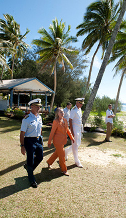 "Secretary Clinton walks with Rear Admiral Charles W. Ray, U.S. Coast Guard, and Admiral Samuel J. ""Sam"" Locklear III, Commander U.S. Pacific Command, at an event commemorating U.S. peace and security partnerships in the Pacific at Tamarind House. [State Department photo by Ola Thorsen/ Public Domain]"