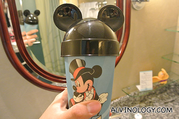 Disney cup with toothbrush and toothpaste inside