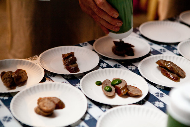 Plating pork sausages with rosemary and anchovy purees