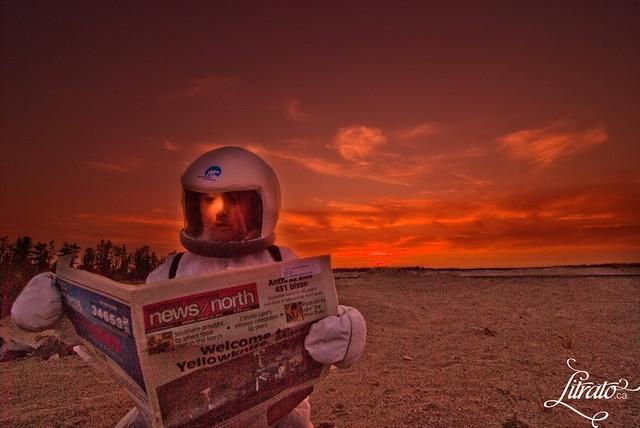 Yellowknifer reading newspaper