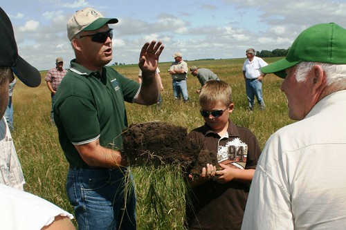 In this photo from the 2009 Society for Range Management (SRM) Award tour, Soil Quality Specialist, Rick Bednarek, formerly of SD, explained the darkness of the soil was due to the organic matter which is the key indicator of the health of soil.