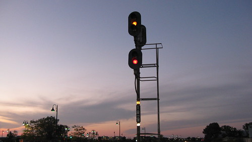 Railroad block signals against the twilight sky.  Glenview Illinois.  September 2012. by Eddie from Chicago