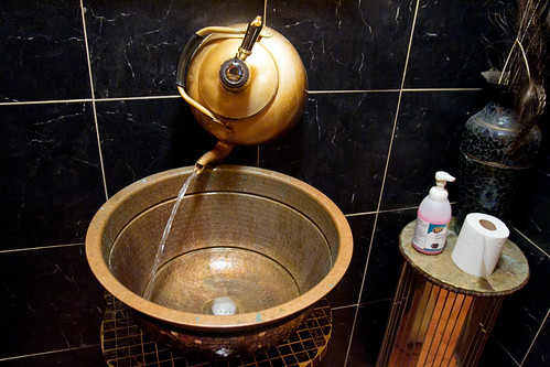 Awesome teapot faucet in the bathroom