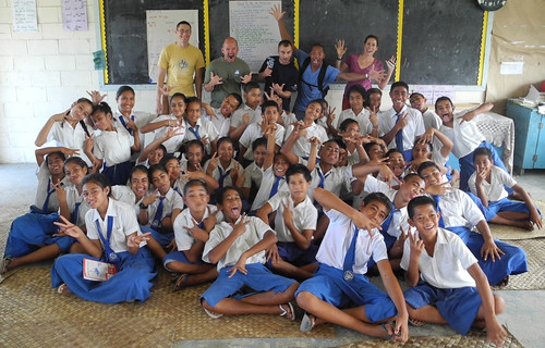 LTJG Sean Dolbow, BM1 Jamie Guy, ENS Corey O'Hara, SK1 Jomar Dunham, and LT Kristen Hahn with Samatau Primary yr. 7 and 8 students.