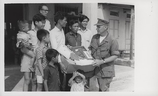 Chaplain Presents Donated Items to Villagers, 31 March 1968