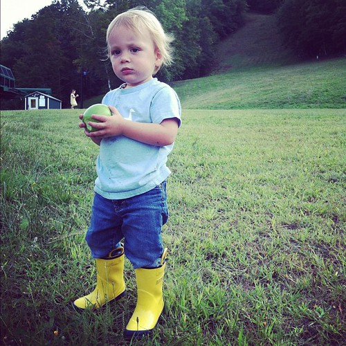 Yellow galoshes, green apple.