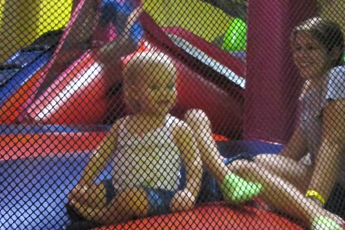Lucy & me in the bounce house. The extra pair of legs there belong to Catie.