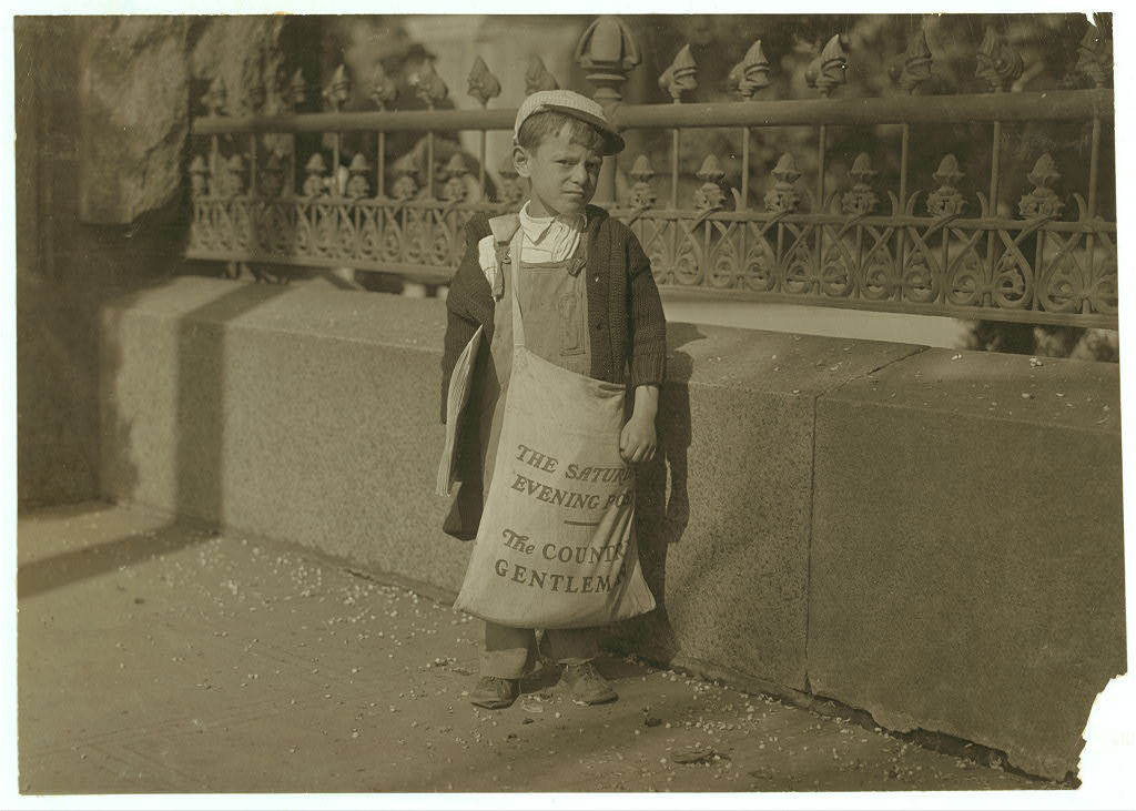 Freddie Kafer, a very immature little newsie selling Saturday Evening Posts and newspapers at the entrance to the State Capitol, Sacramento, California