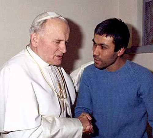 Pope John Paul and the man who tried to kill him.