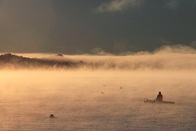 canoeing in morning fog